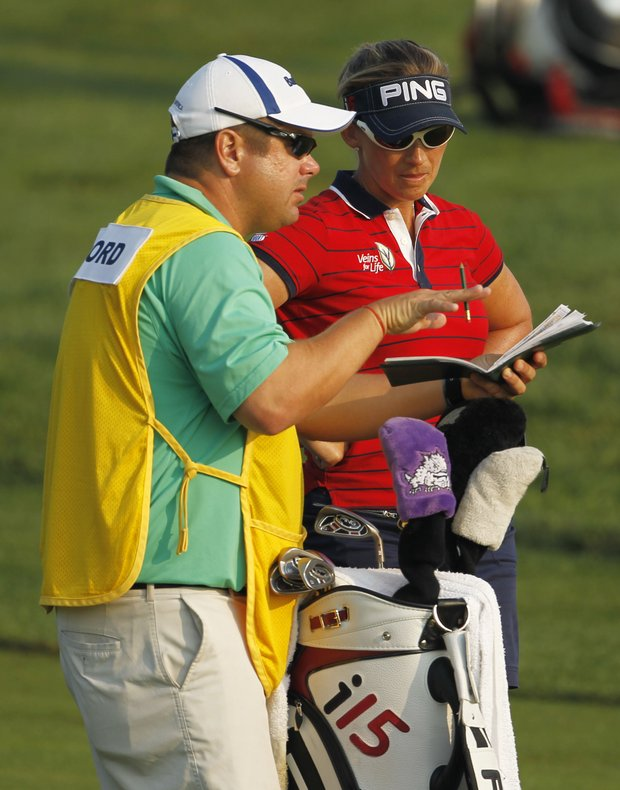 Angela Stanford talks with her caddie during the first round of the U.S. Women's Open.