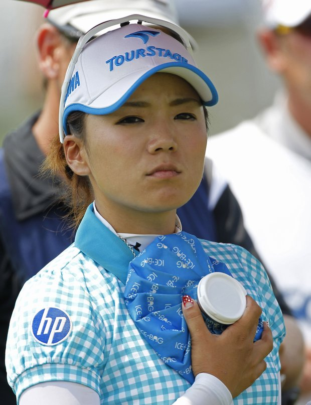 Chie Arimura holds an ice pack during the first round of the U.S. Women's Open.