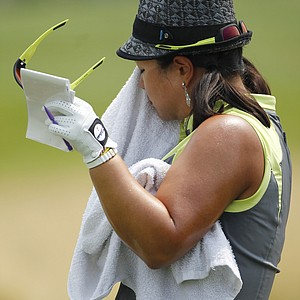 Christina Kim wipes the sweat from her face during the first round of the U.S. Women's Open.