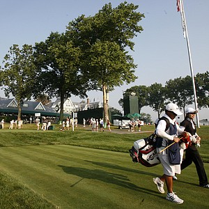 Eun-Hee Ji, right, walks off the first tee during the first round of the U.S. Women's Open.