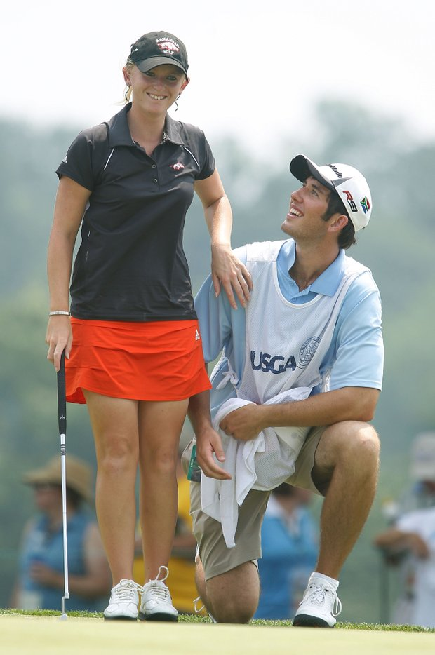Amateur Kelli Shean waits with her caddie, Chandler Rackley, on the 17th green during the first round of the U.S. Women's Open.