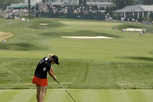 Kelli Shean hits her tee shot on the 18th hole during the first round of the U.S. Women's Open.