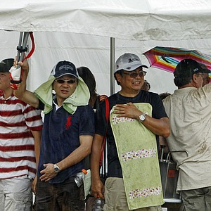 Patrons take shelter as heavy rain rolled through Oakmont Country Club during the second round of the U.S Women's Open.