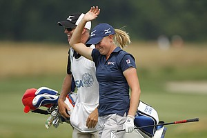 Stacy Lewis waves to the crowd after making eagle on the fourth hole during Round 2 at Oakmont.