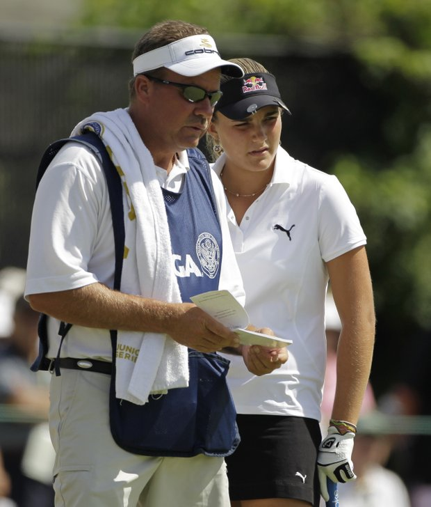 Alexis Thompson with her caddie and father, Scott.