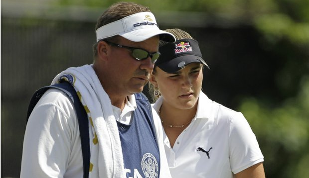 Alexis Thompson (right) with her father and caddie, Scott.