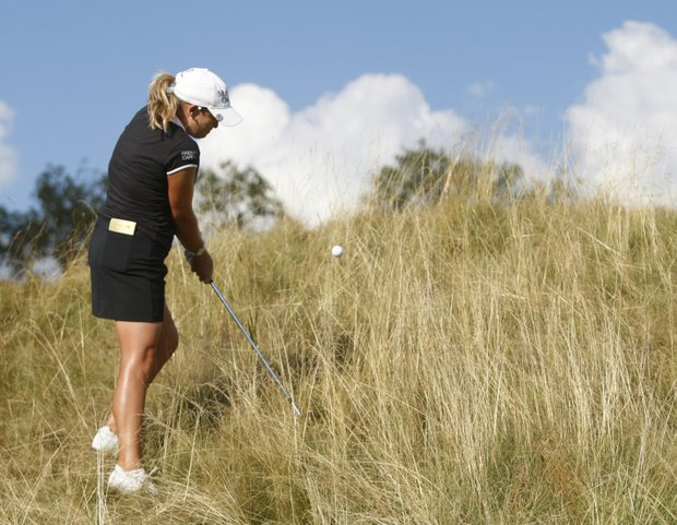 Cristie Kerr hits out of fescue at the fifth hole.