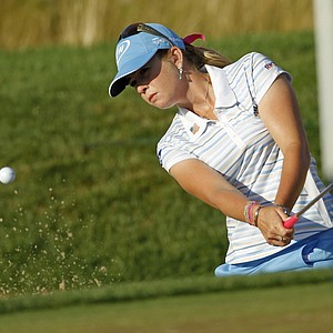 Leader Paula Creamer blasts out of the sand at No. 7.