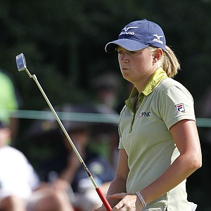 Stacy Lewis watches a putt at the first hole during a long Saturday at the U.S. Women's Open.
