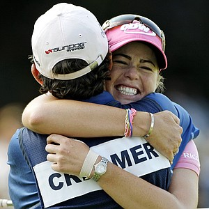 """""""I'll probably sleep with an ice bag on. I'm afraid to take the tape off – my thumb is going to explode out of it. But the more I think about making pars, the less the thumb bothers me."""" - Paula Creamer on the pain in her thumb after the third round of the U.S. Women's Open at Oakmont. She led by 3 strokes heading into the final round. Above, Creamer Creamer hugs her caddie, Colin Cann, after winning the tournament."""