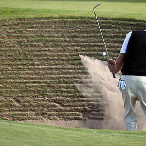 Bo Van Pelt plays out of the bunker during a practice round for the British Open.