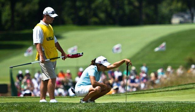 Greg Robertson and Maria Hernandez survey a putt at Oakmont.