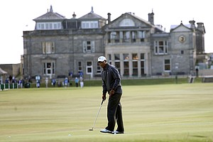Tiger Woods putts out on the 17th hole at the Old Course.