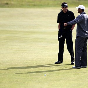 Tiger Woods, right, talks with Robert Allenby, during a practice round at the Old Course.