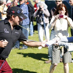 Graeme McDowell signs autographs during a practice round for the British Open.