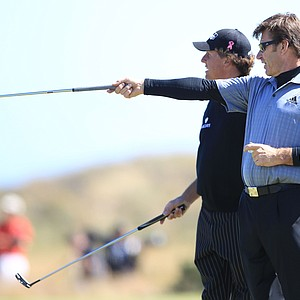 Nick Faldo confers with Phil Mickelson at the Old Course at St. Andrews.