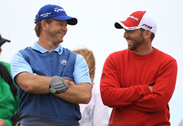Retief Goosen and Sergio Garcia share a laugh during a practice round for the British Open.