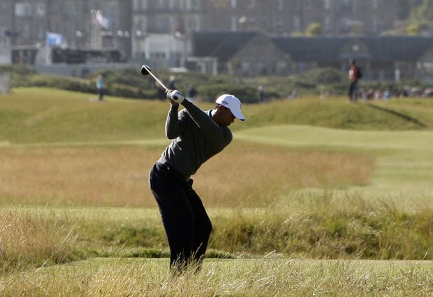 Tiger Woods tees off on the 15th hole at the Old Course at St. Andrews.