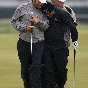 Angel Cabrera, right, and Jose Manuel Lara walk together on the second green during a practice round on the Old Course at St. Andrews.