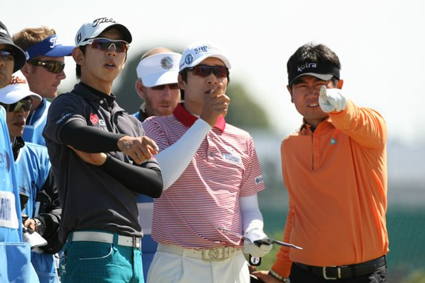 Noh Seung-yul (left) with compatriots Kim Kyung-tae and Y.E. Yang during a practice round at St. Andrews.