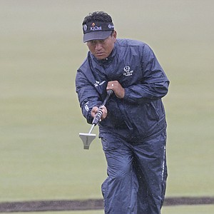 KJ Choi of South Korea putts on the second green during a practice round on the Old Course at St. Andrews.