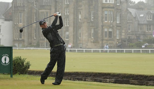 Luke Donald tees off during a practice round Wednesday at soggy St. Andrews.