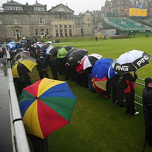 Spectators look out near Nos. 1 and 18 at the Old Course at St. Andrews.