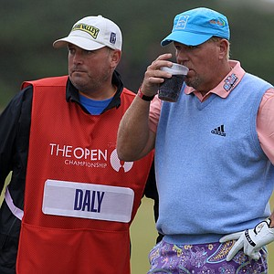 John Daly opened with a 6-under 66 at St. Andrews.