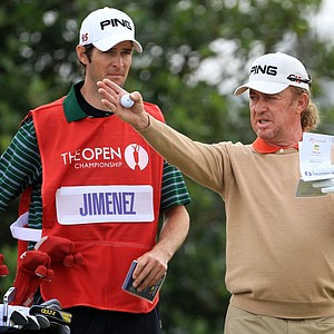 Miguel Angel Jimenez talks with his caddie at the Old Course at St. Andrews.