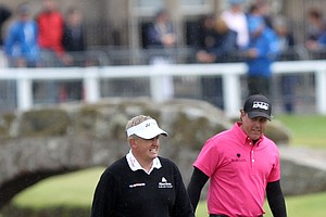 Colin Montgomerie and Phil Mickelson walk to the first hole during Round 1 of the British Open.
