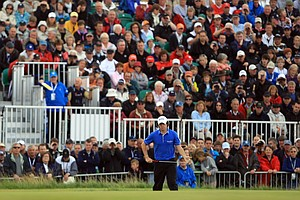 Rory McIlroy prepares to putt at the 16th green during Round 1 of the British Open.