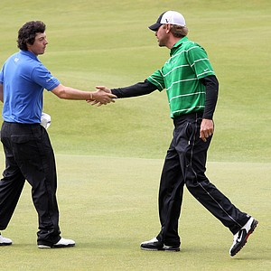 Rory McIlroy and playing partner Lucas Glover shake hands following the first round of the British Open.