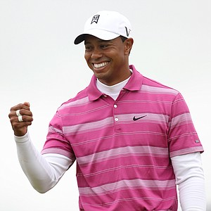 Tiger Woods pumps his fist during Round 1 of the British Open.