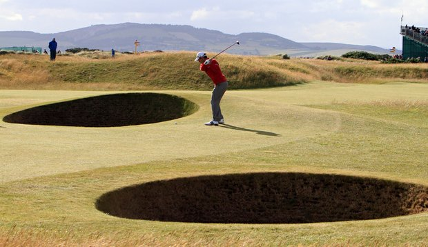 Mike Weir hits a shot from the sixth fairway Friday at the British Open.