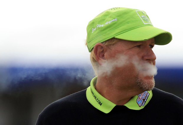 John Daly smokes a cigarette during the second round of the British Open.