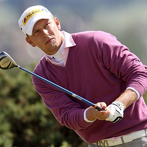 Marcel Siem leans to watch his drive during Round 2 at the Open.