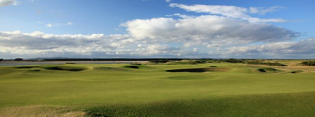 The 11th green (left) and seventh green (right) on the Old Course at St. Andrews.