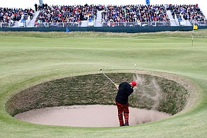 John Daly plays out of a bunker at the seventh hole at St. Andrews.