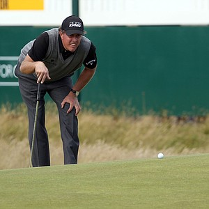 Phil Mickelson reads a putt at the 14th green during Round 3 of the British Open.