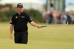 Lee Westwood reacts after a putt on the 10th green during the final round of the British Open.