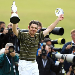 Louis Oosthuizen holds the Claret Jug after winning the British Open.