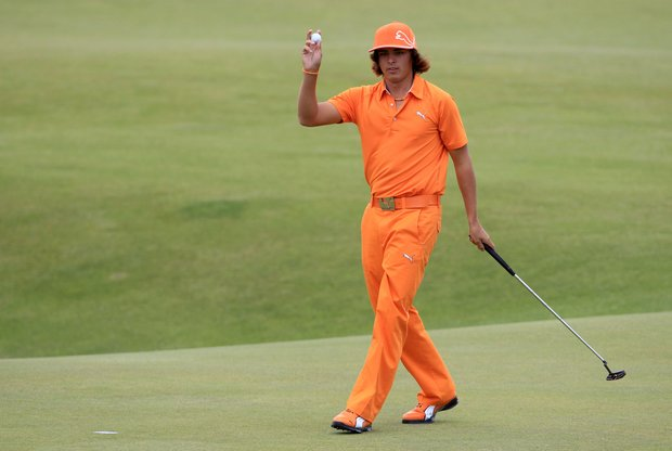 Rickie Fowler waves to the crowd on the 18th green after his final round of the British Open.