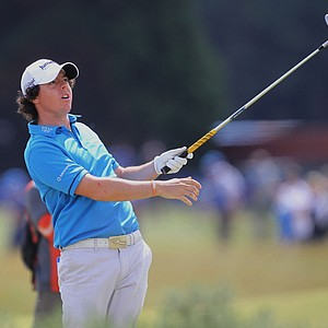 Rory McIlroy watches his shot from the rough on the second hole during his final round of the British Open Golf Championship on the Old Course at St. Andrews, Scotland, Sunday, July 18, 2010. (AP Photo/Peter Morrison)
