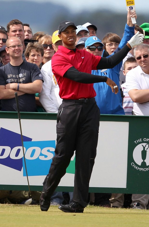 Tiger Woods drops his club after hitting off the 13th tee during the final round of the British Open.