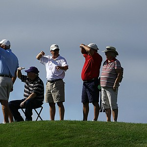 Spectators line the hills at No. 9 to watch groups as they come through during Monday stroke play.