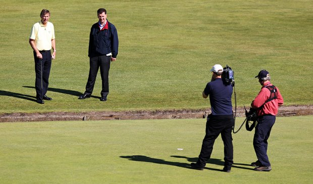 BBC television commentator Ken Brown and R&A Rules Secretary David Rickman talk in front of the first green during a practice round for the 2010 British Open.