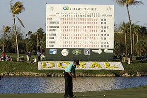 Charl Schwartzel putts on the 18th green during the third round of the CA Championship in Doral, Fla.