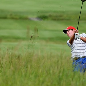 Charlie Saxon of Tulsa, Okla., tries to get out of the deep rough at No. 17.