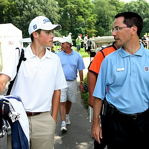Gavin Hall of Pittsford, N.Y., walks with Egypt Valley head pro, Jim Amiot after shooting a record 62 during Tuesday stroke play.