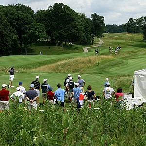 A crowd gathers at No. 1 to watch defending champion Jordan Spieth tee off.